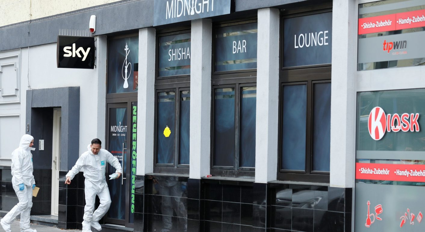 Forensic investigators enter the Midnight Shisha bar after a shooting in Hanau