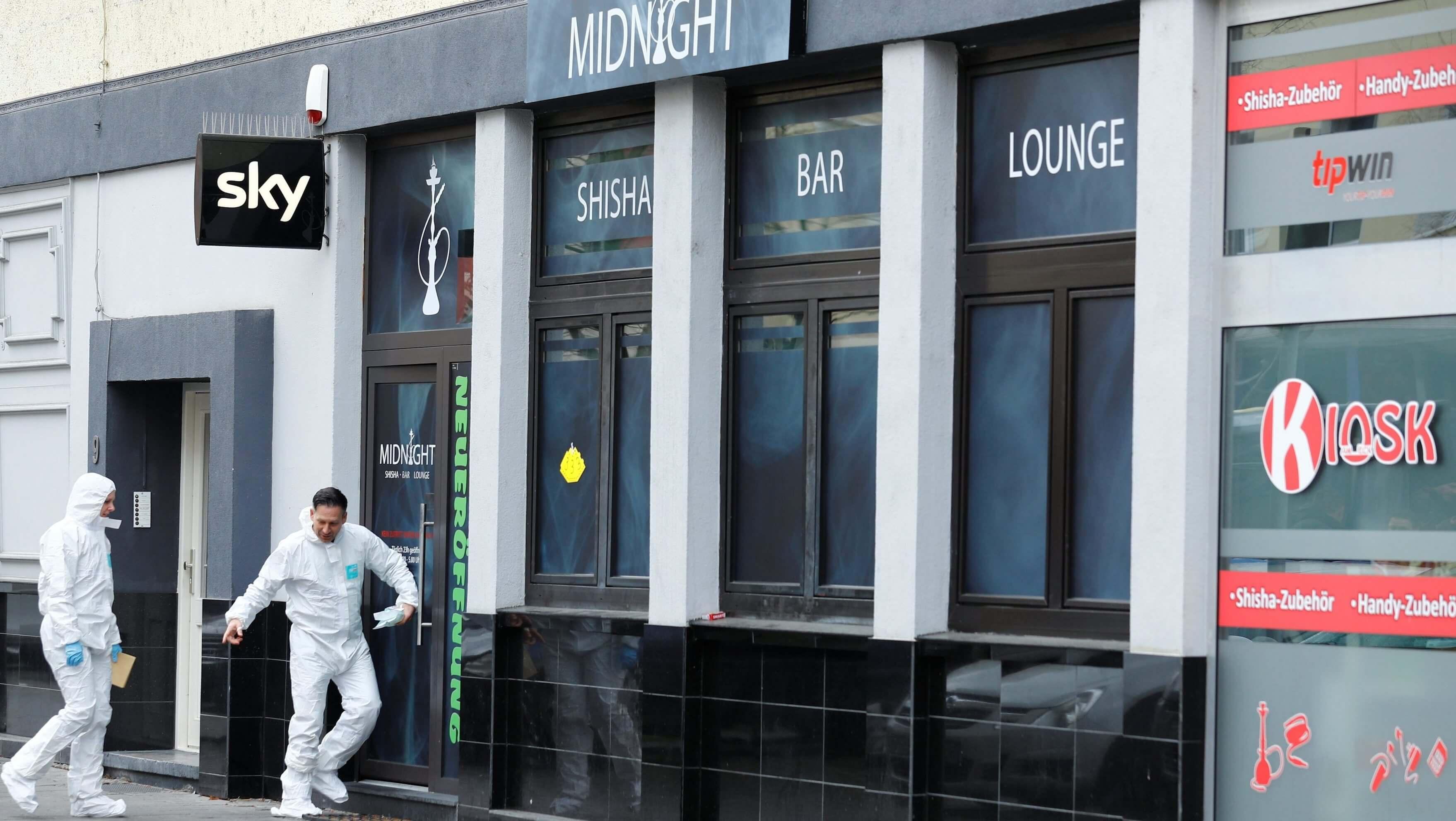 Forensic investigators enter the Midnight Shisha bar after a shooting in Hanau