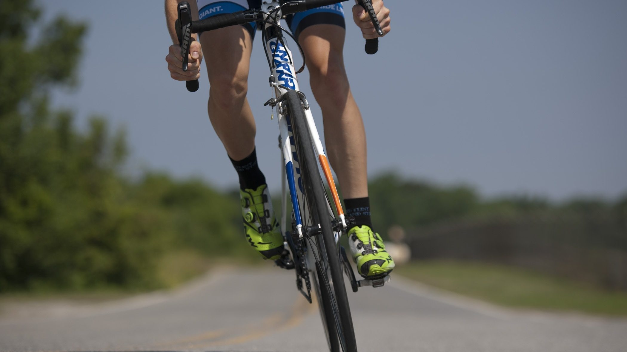 person-riding-road-bike-on-the-road-38296